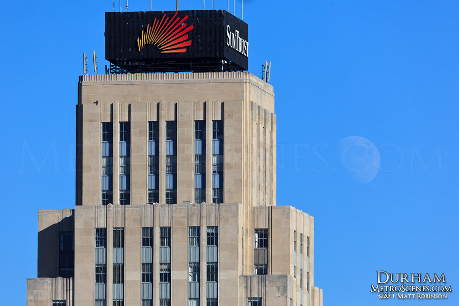 Daytime moonrise behind Durham's Hill Building (SunTrust Tower)