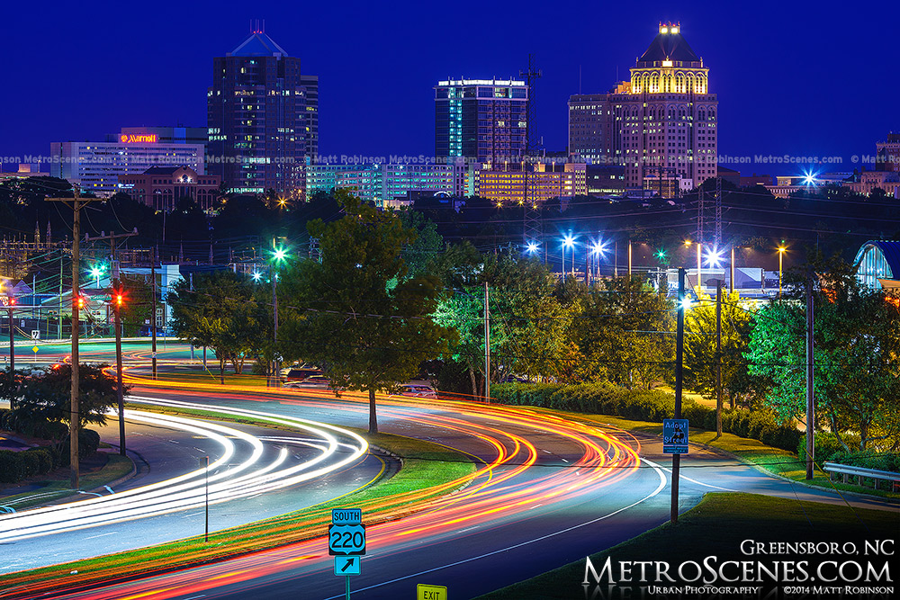 Greensboro Skyline 2014 at night with traffic