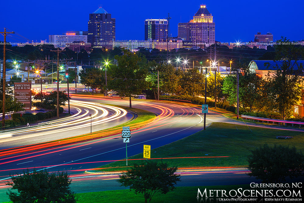Greensboro North Carolina at night with traffic on Battleground Avenue