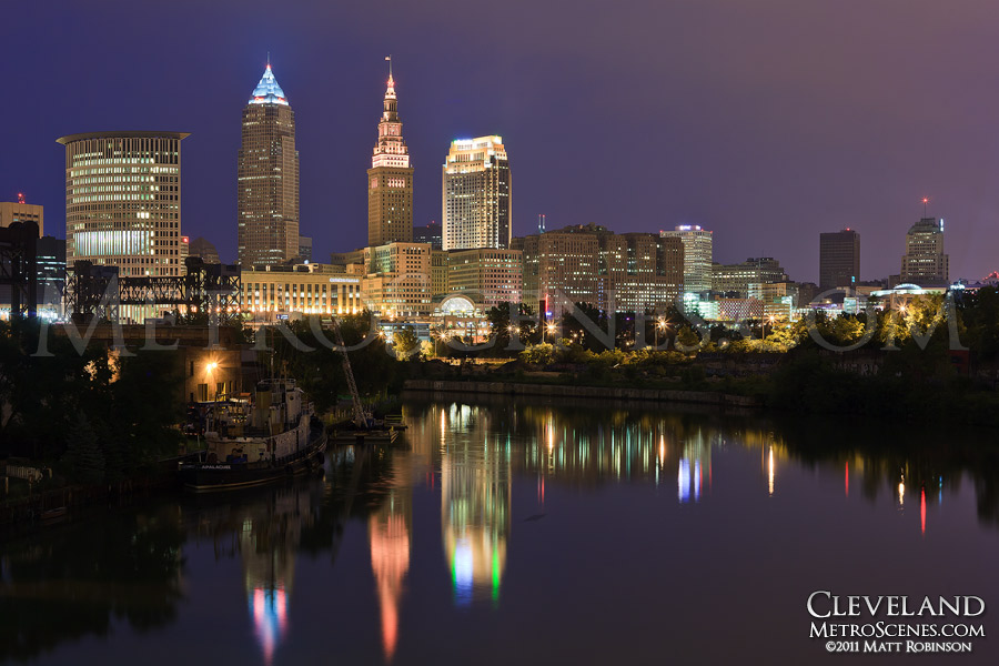 The Cleveland Skyline reflects in the Cuyahoga River from the Flats at night