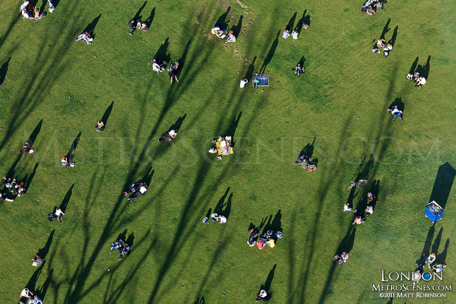 People with Shadows in Jubilee Gardens, London