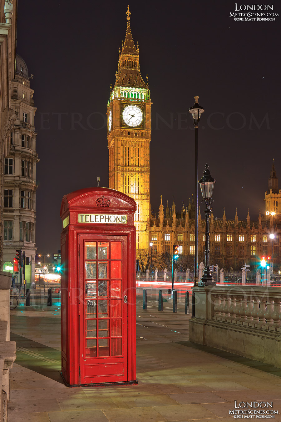 Red London Telephone Box with the Tower of Big Ben at night