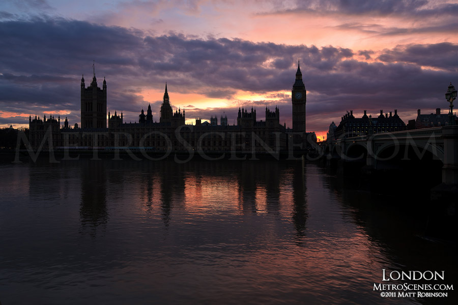 Sunset behind the Palace of Westminster on the River Thames in London, England