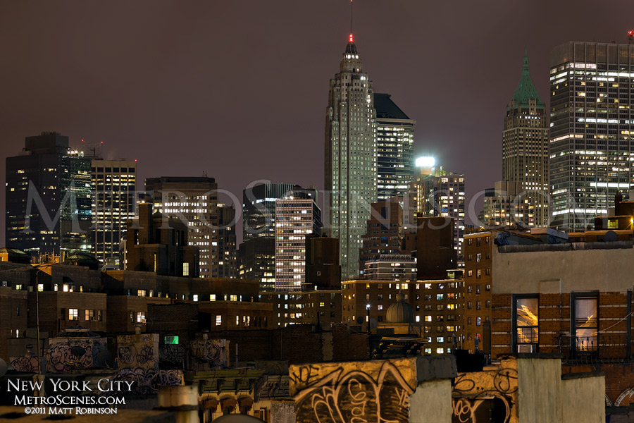 American International Building and Woolworth Building at night