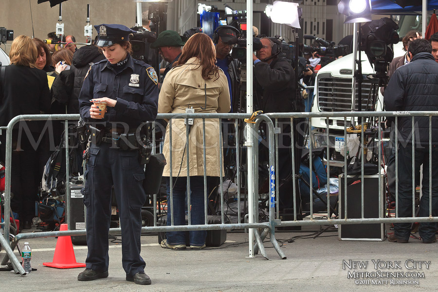 NYPD Officer among a media circus