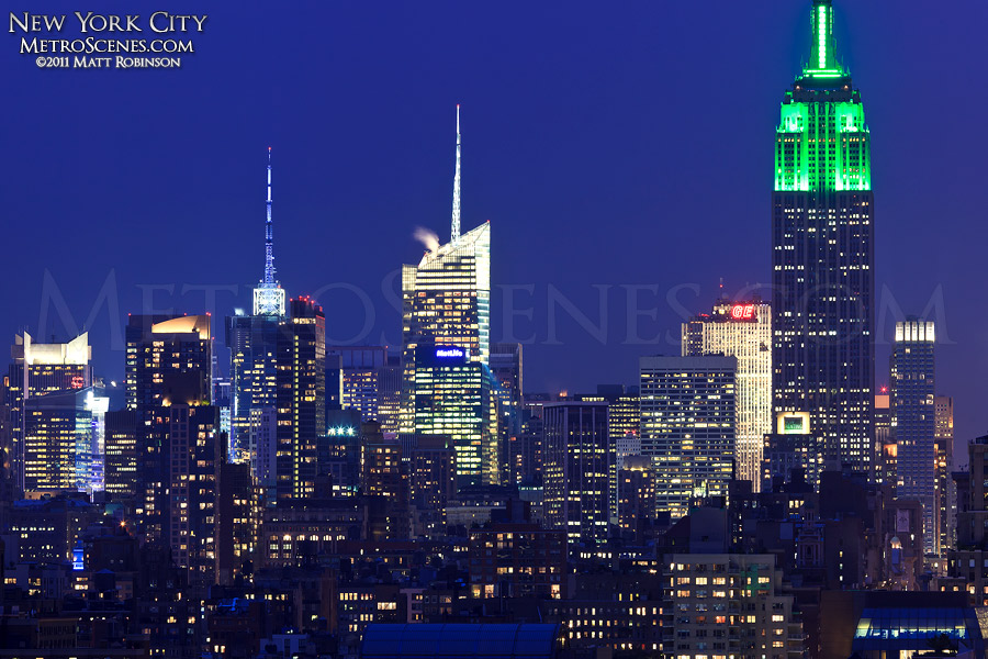Green illuminated Empire State Building