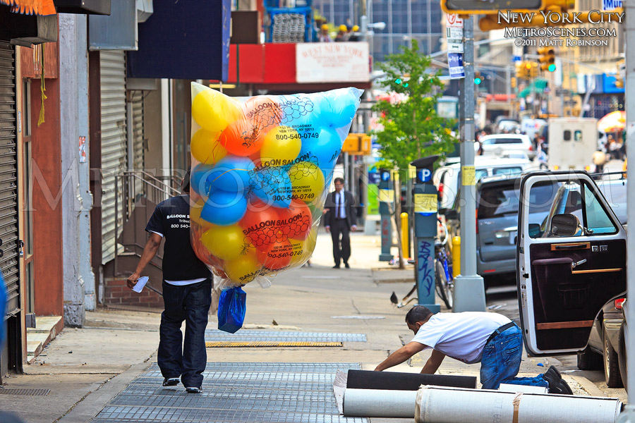 Man with bag of Balloons in NYC