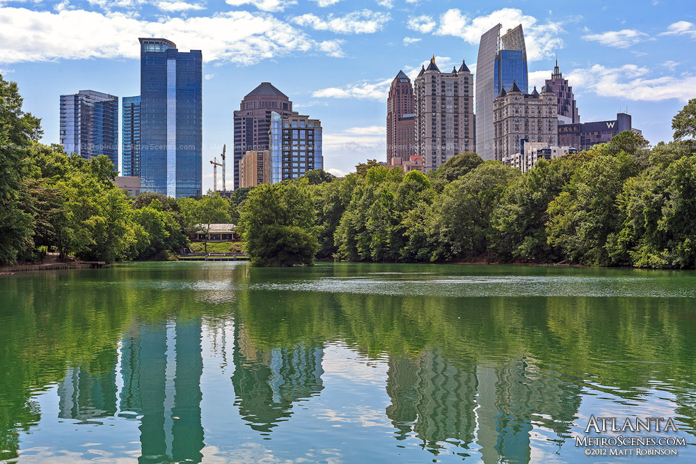 Midtown Atlanta reflects in Lake Clara Meer in Piedmont Park
