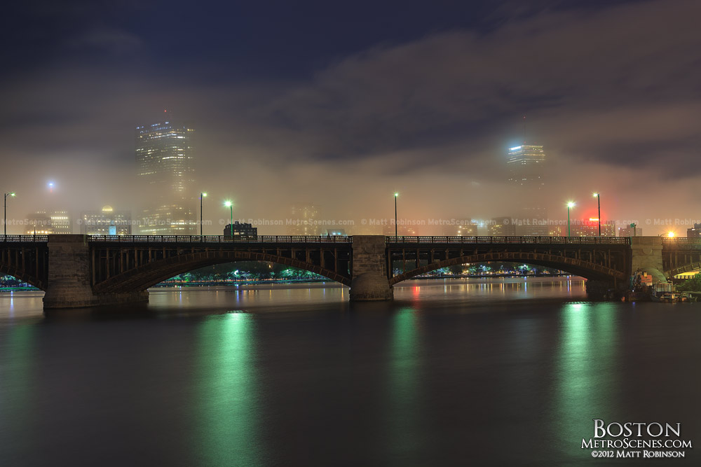 Fog obscures John Hancock Tower and Prudential Center over the Charles River
