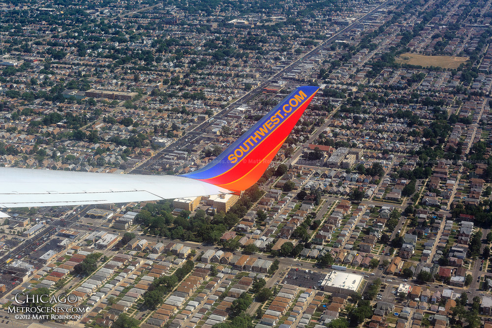 Airline wing over Residential Chicago