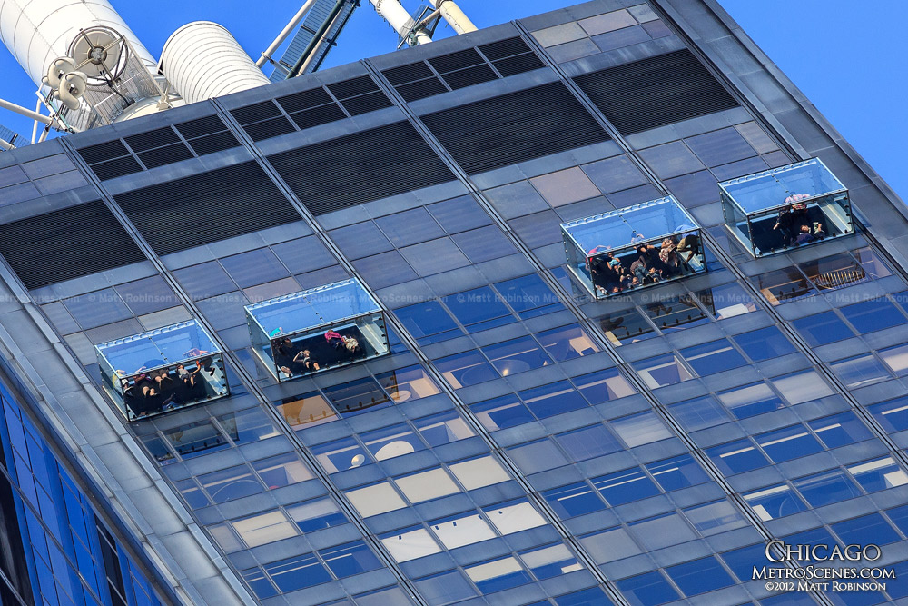 People stand on The Ledge at the Willis Tower Skydeck