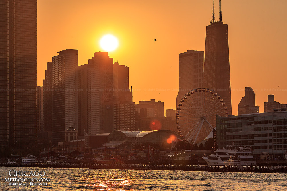 The setting sun behind Navy Pier