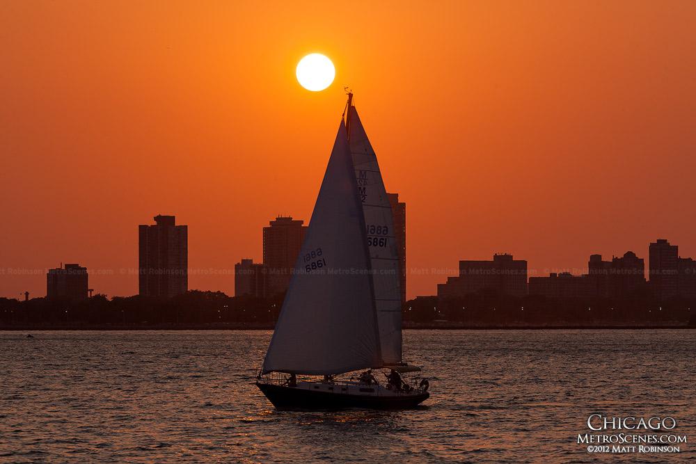 Sun setting behind Sailboat on Lake Michigan