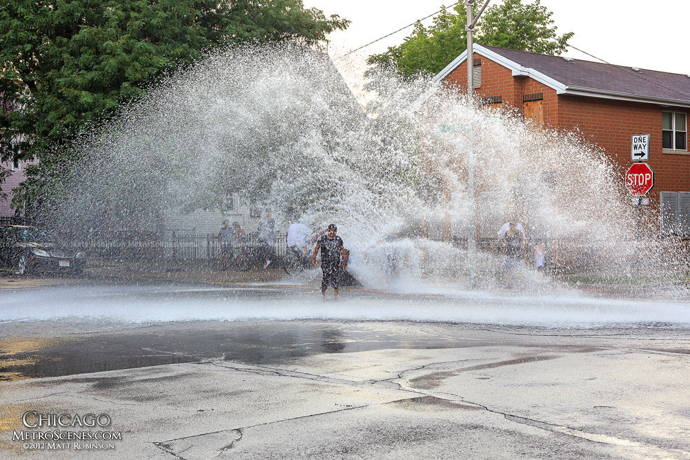Fire hydrant spray cools off the Chicago summer heat