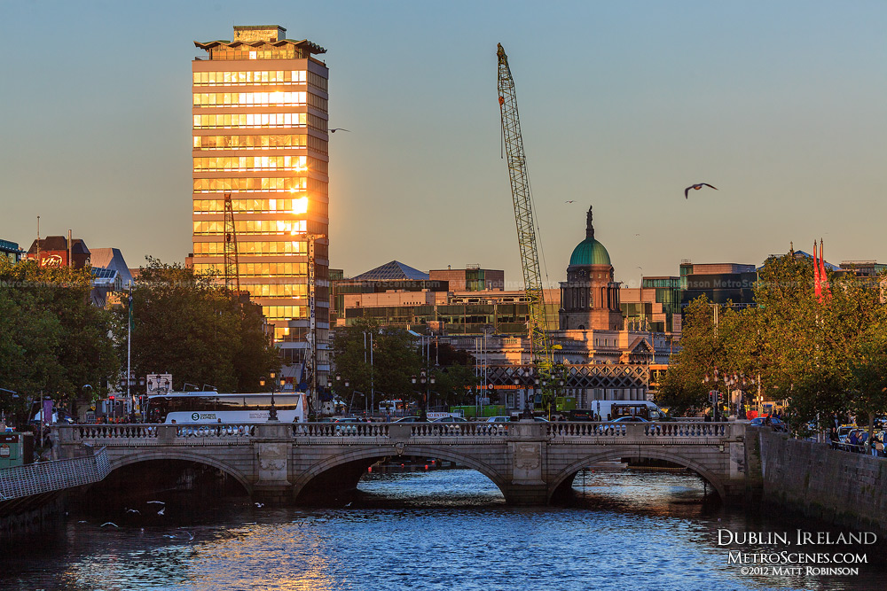 Sun reflects off of Liberty Hall along the River Liffey in Dublin