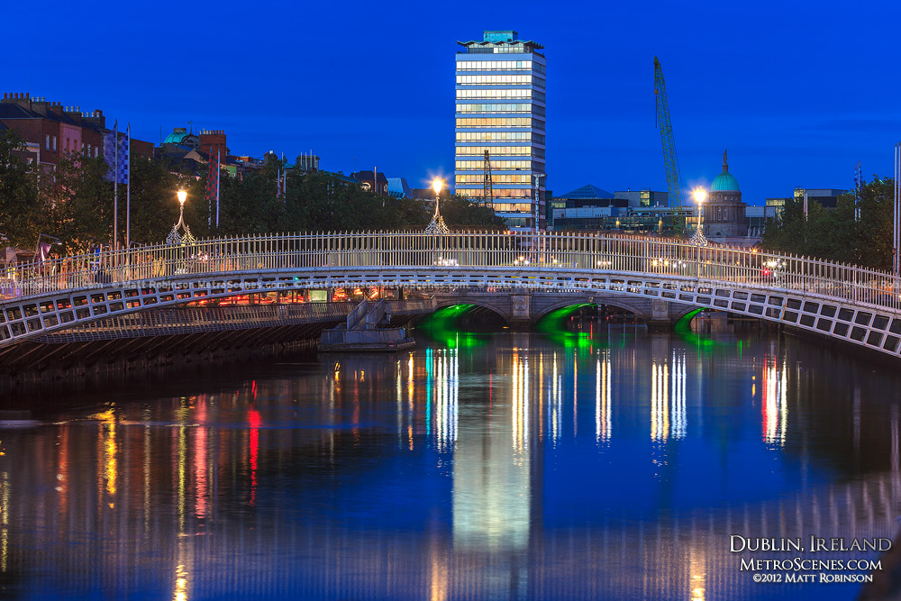 Liberty Hall reflects in the River Liffey with the Ha'Penny Bridge