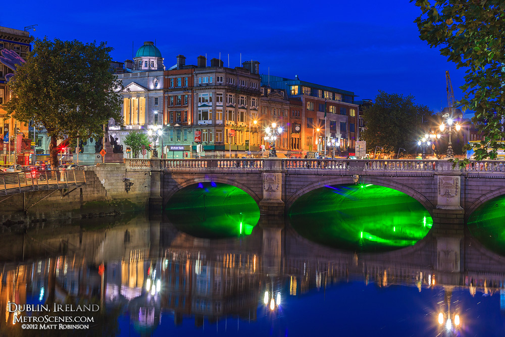 O'Connell Bridge with green lighting at dusk in Dublin