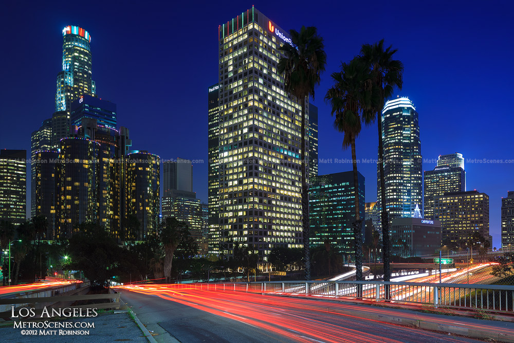 Los Angeles Skyline at night with Palm Trees - US Bank Tower and Union Bank Plaza