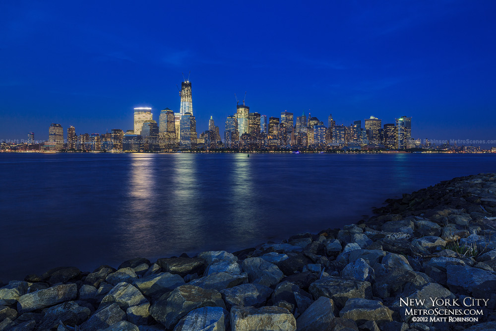 Lower Manhattan cityscape at night from New Jersey