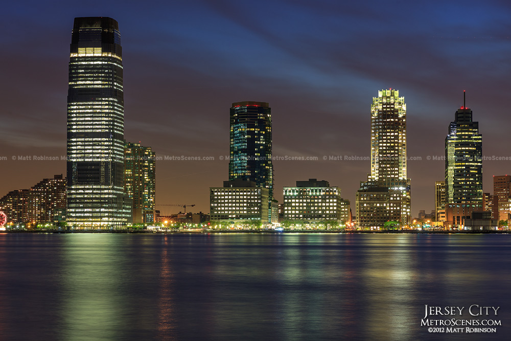 Downtown Jersey City Skyline and shore front at night