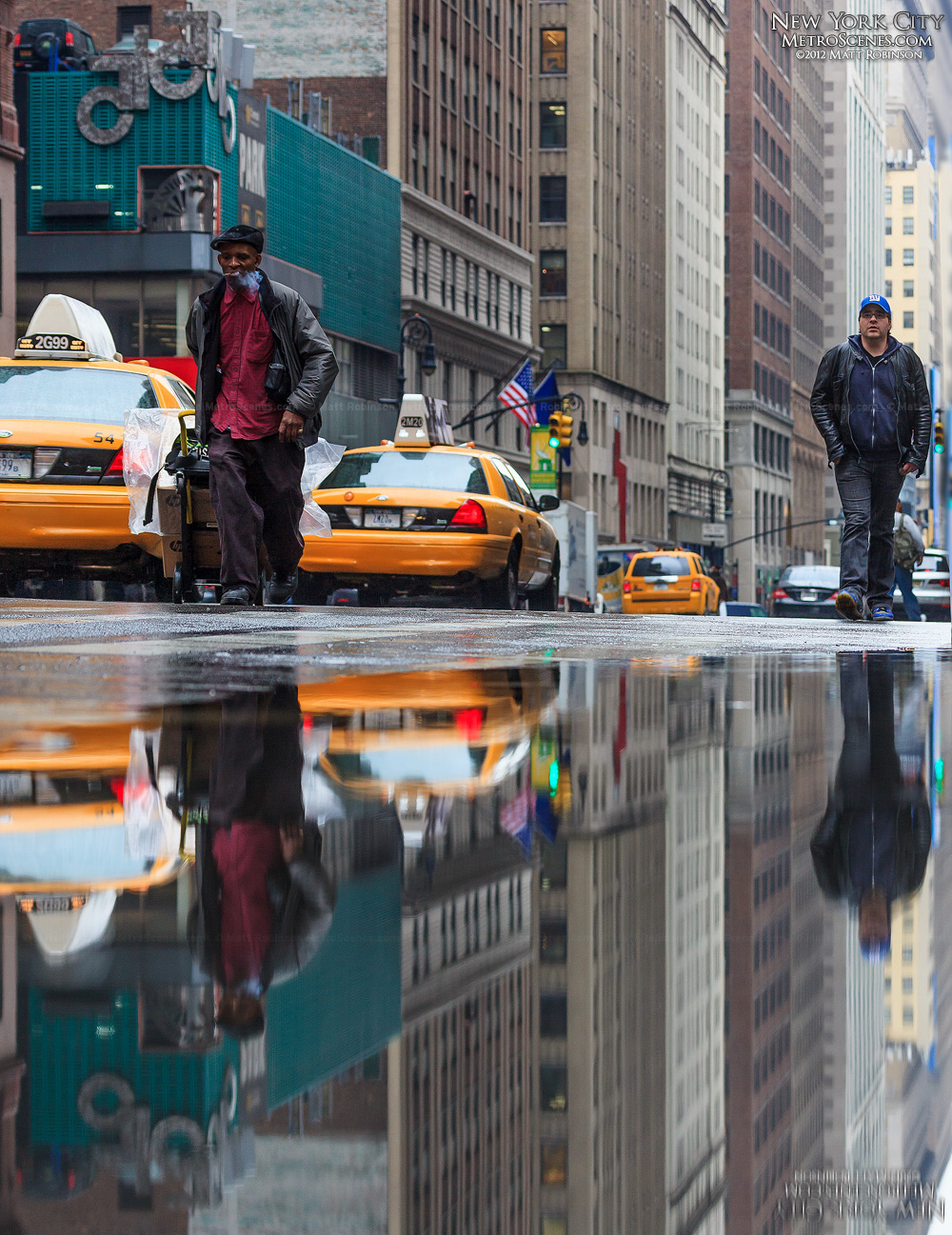 Puddle reflections on Seventh Avenue in New York