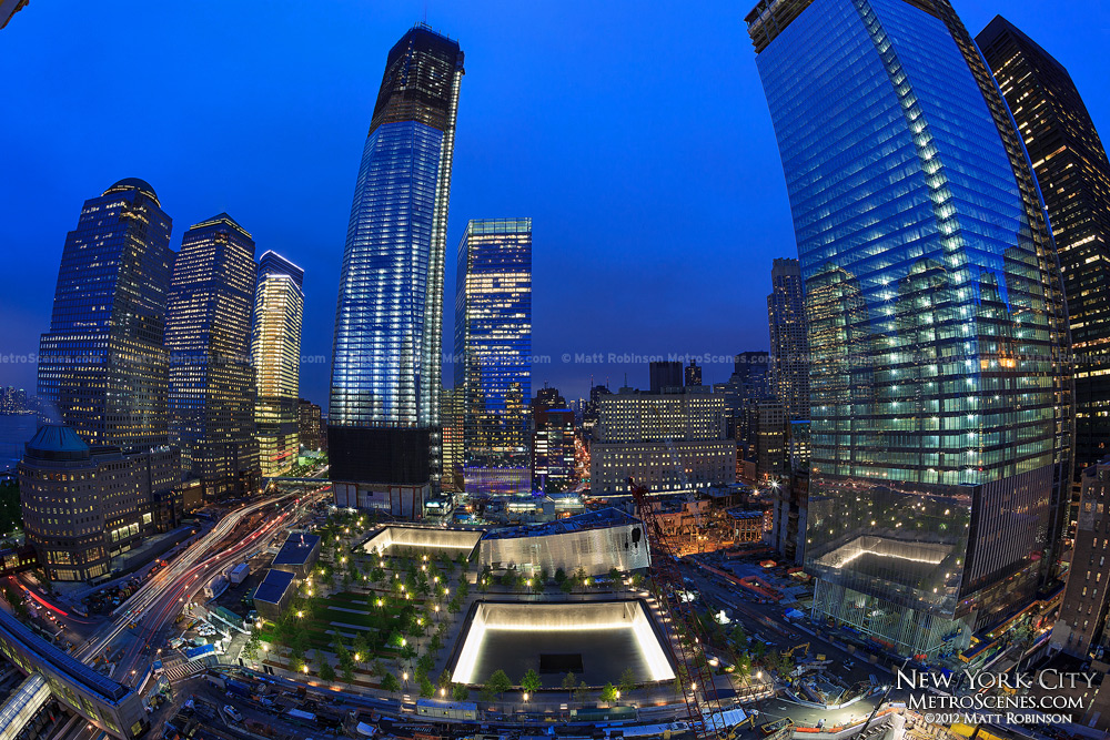 One World Trade Center rises above the September 11th Memorial at night