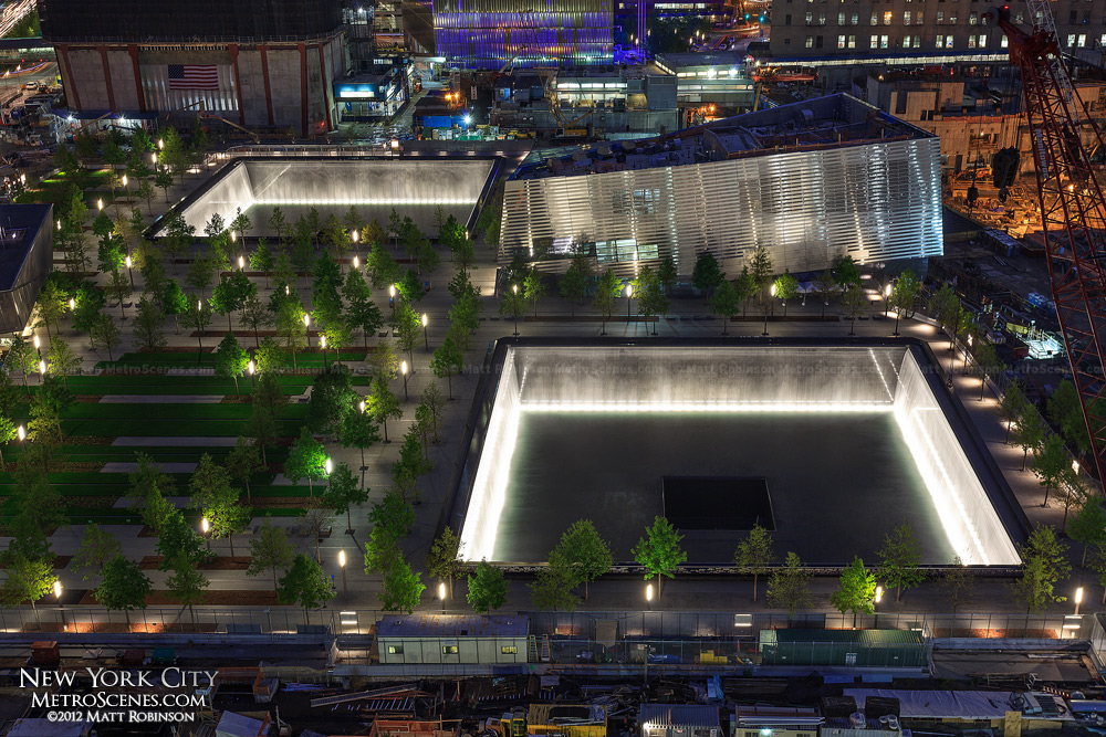 The 9/11 Memorial Pools illuminated at night