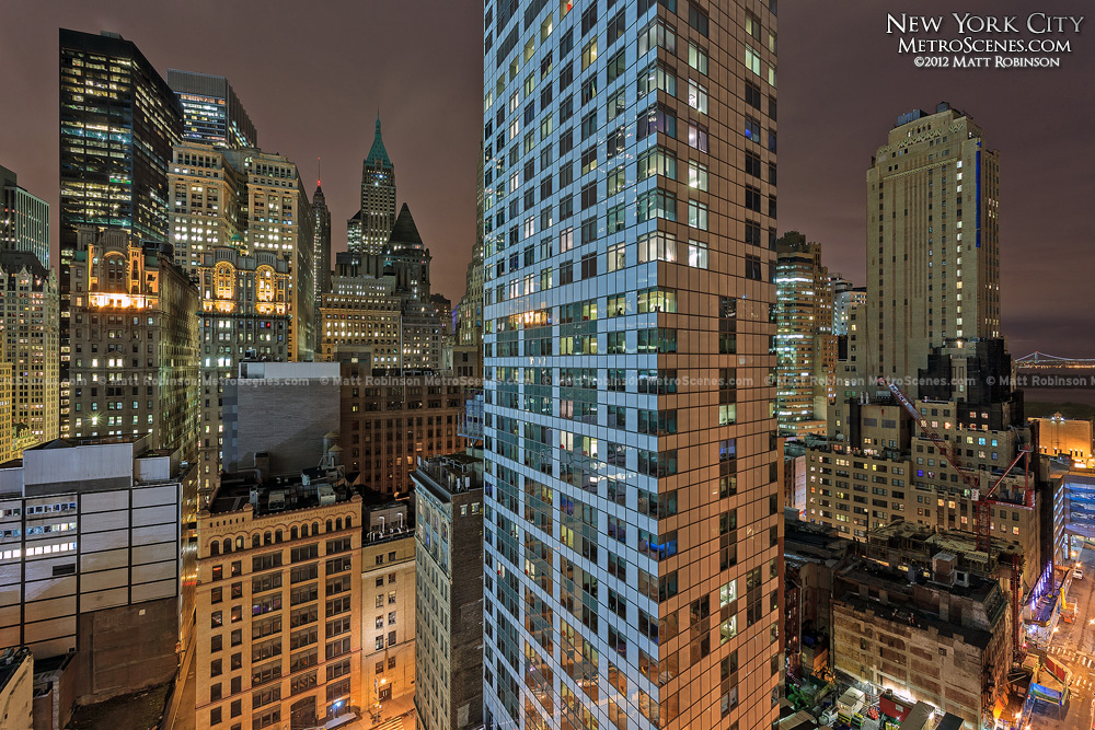W New York Downtown Hotel at night with surrounding buildings