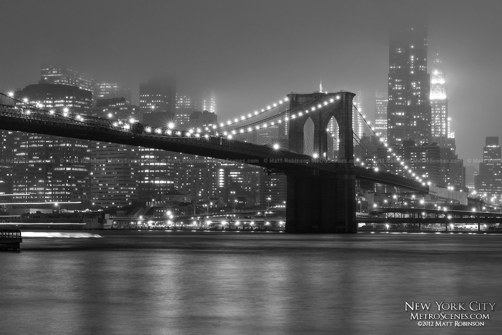 Fog obscures Lower Manhattan with the Brooklyn Bridge