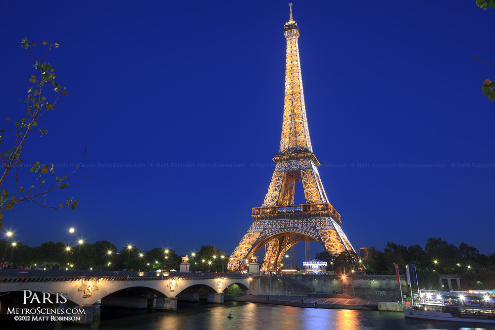 Eiffel Tower flashing with the River Seine at night