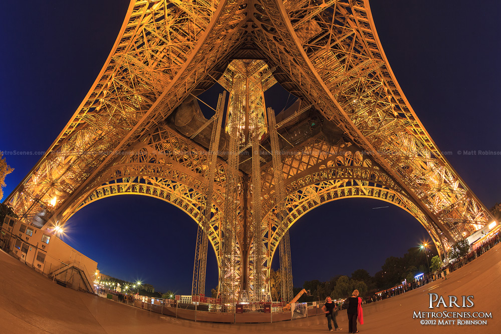 Fisheye of the Eiffel Tower base at night