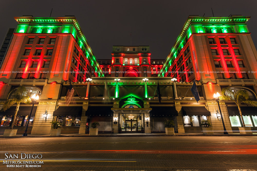 The US Grant Hotel illuminated red and green for the Holidays