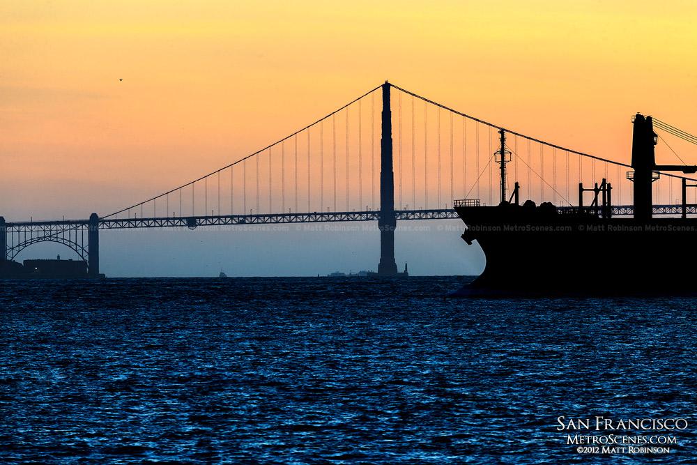 Silhouette of the Golden Gate Bridge and oil tanker