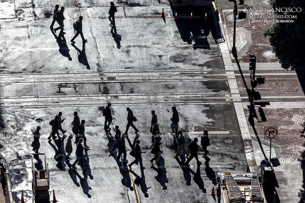 Pedestrians cross Ellis Street in the morning