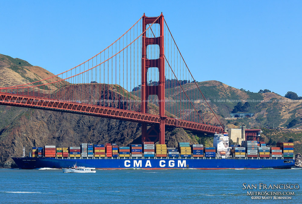 Cargo ship passes under the north tower of the Golden Gate Bridge