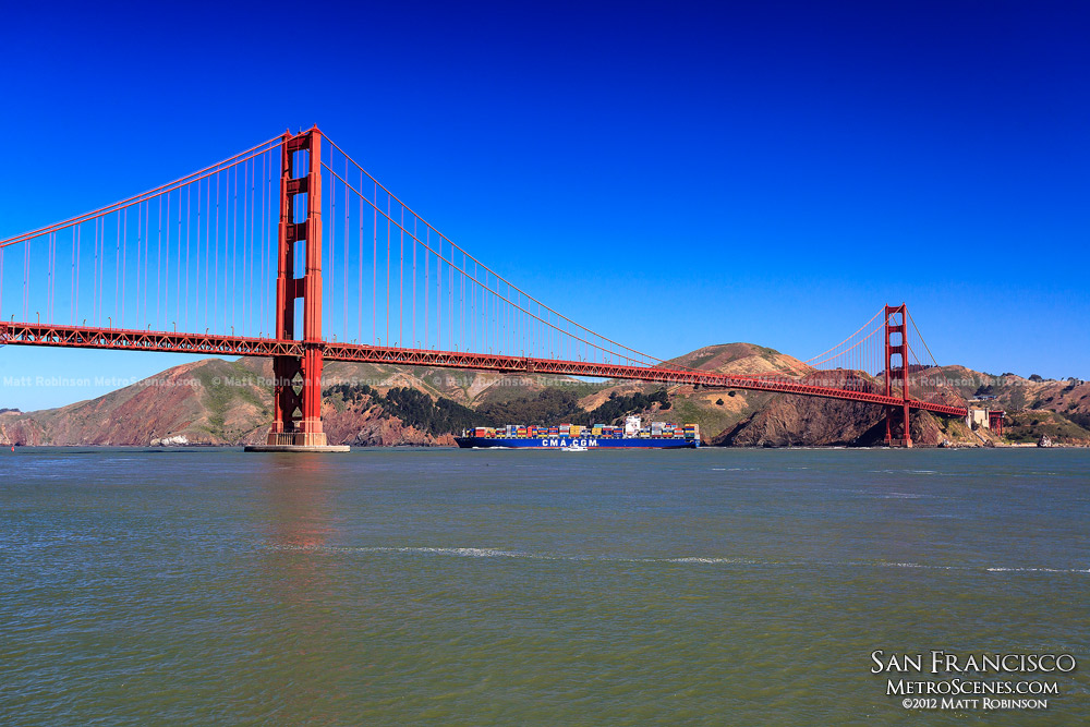 Cargo ship passes under the Golden Gate Bridge