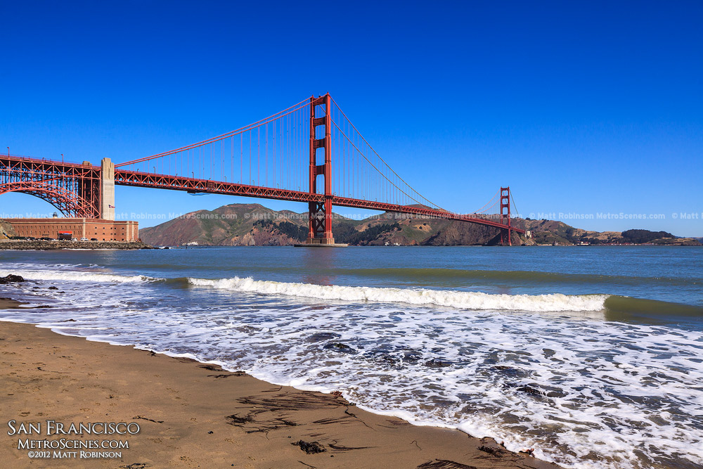 Golden Gate Bridge with shoreline near Fort Point