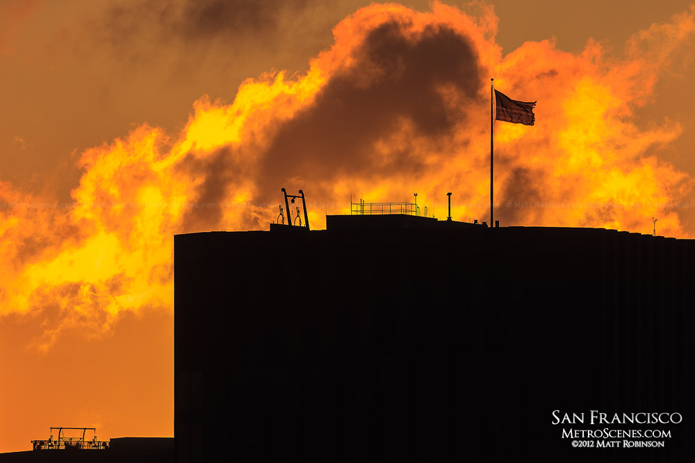 Silhouette of American Flag on top of building in San Francisco