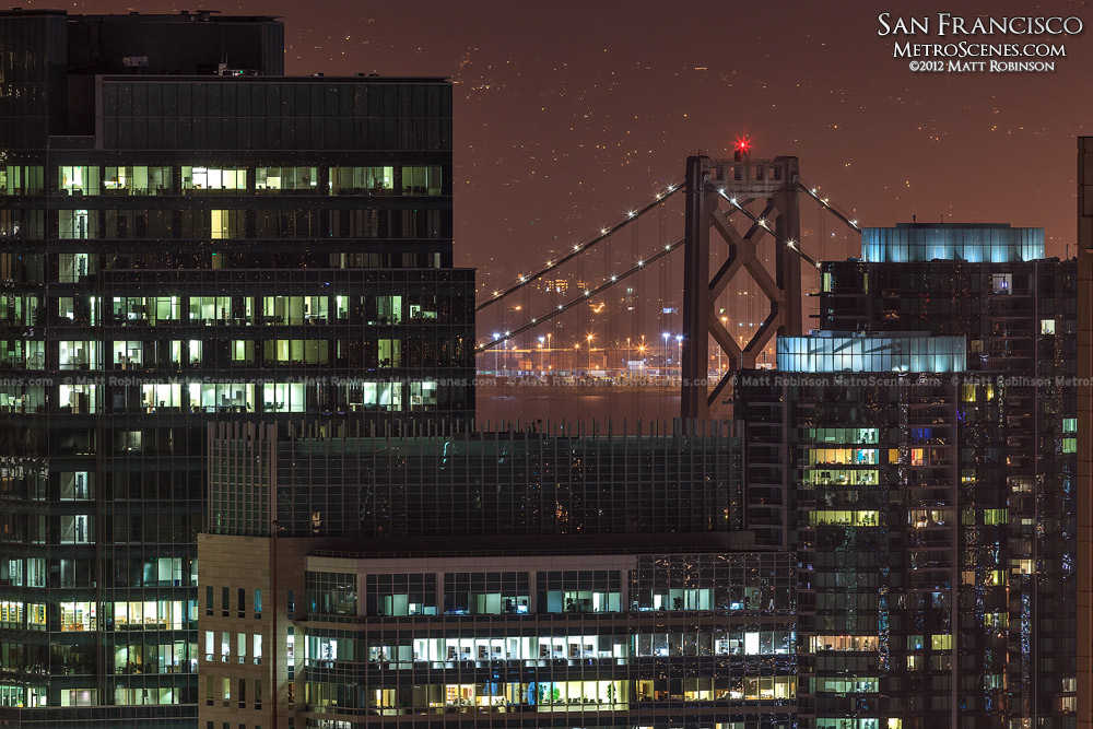 Bay Bridge peeks over San Francisco buildings