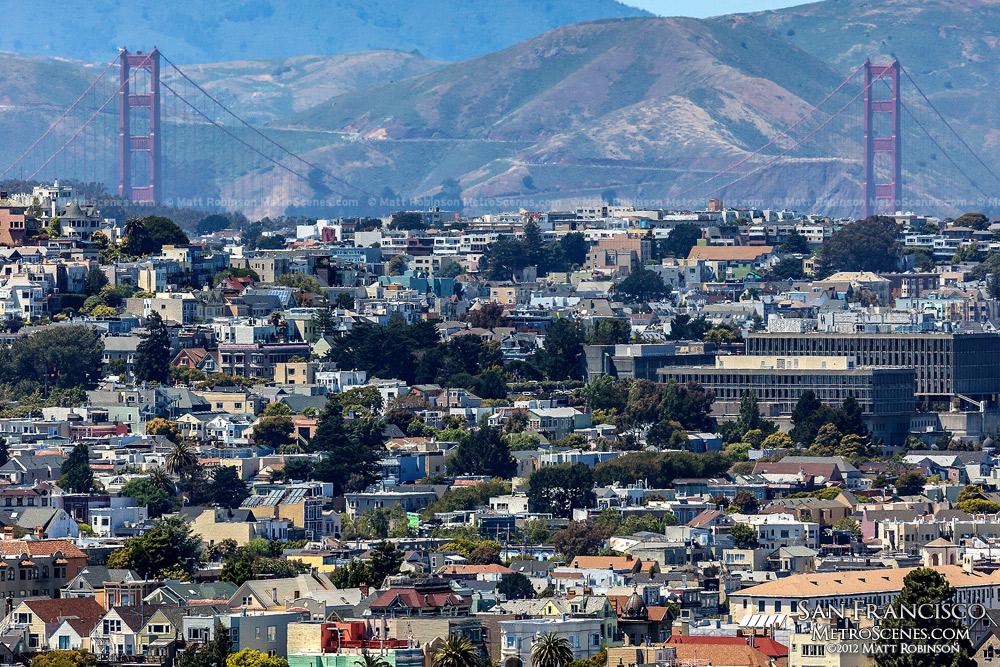 Golden Gate Bridge rises over Laurel Heights