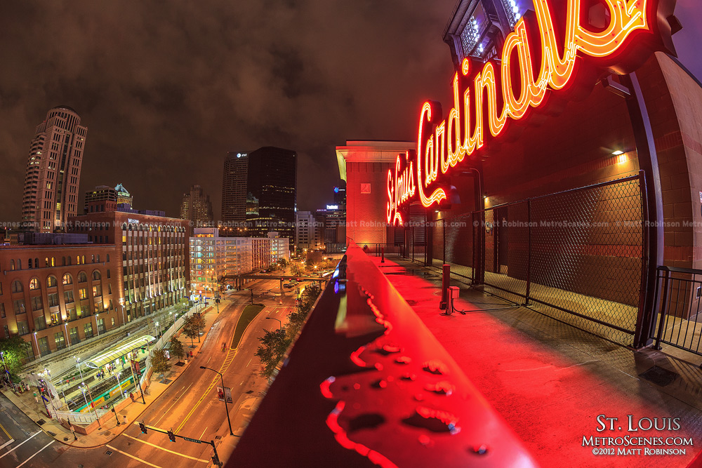 St. Louis Cardinals neon sign with downtown from Busch Stadium
