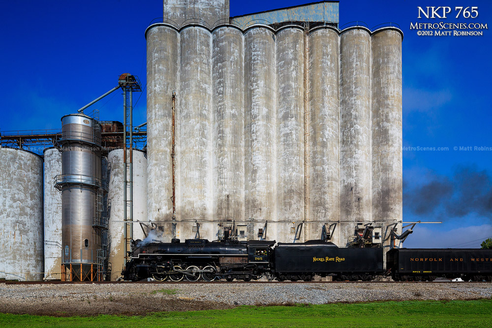 Nickel Plate Road 765 passes a grain elevator in Stonington, Illinois