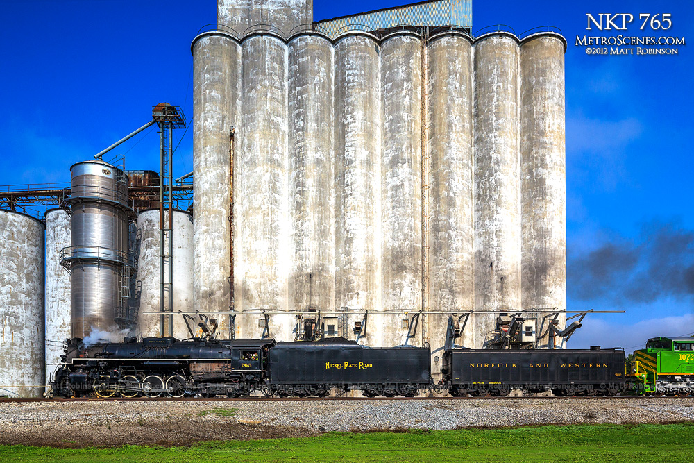 NKP 765 passes grain elevators