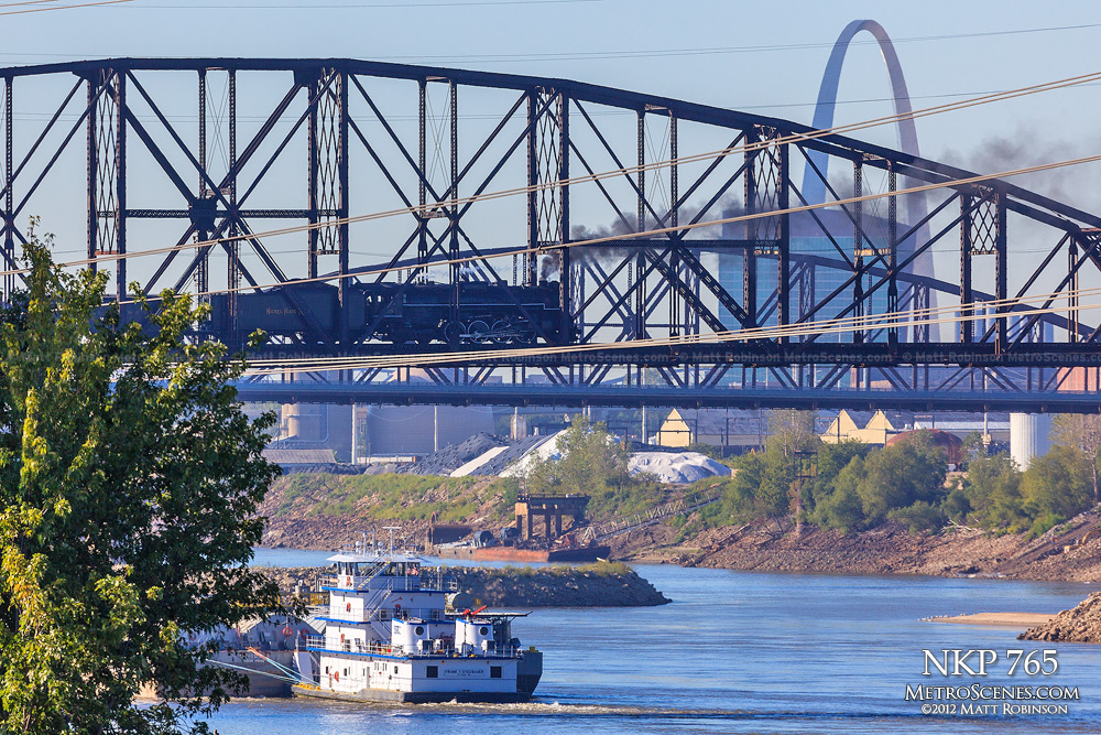 NKP 765 crosses the Mississippi River with St. Louis Gateway Arch and a tugboat