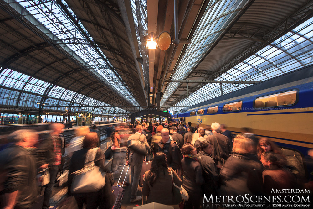 Rush of riders exit Amsterdam Centraal