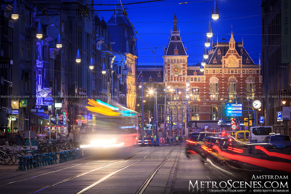 Traffic streams down Damrak towards Amsterdam Centraal