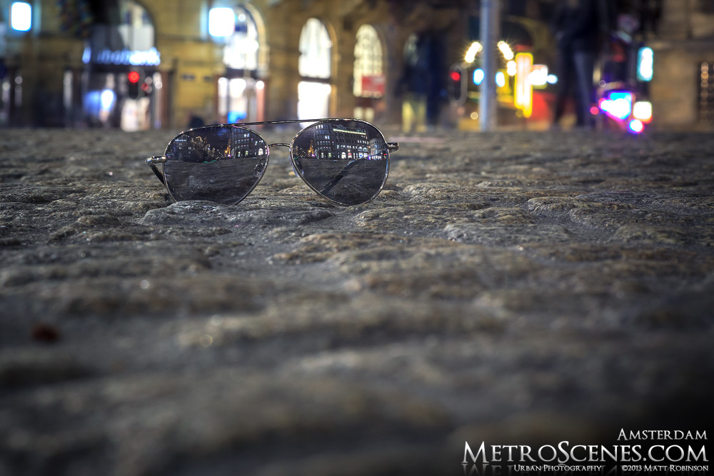 Sunglasses at night reflections in Dam Square
