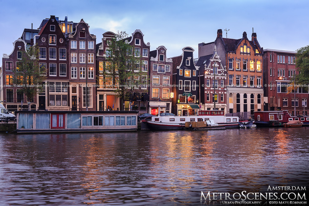 Tilted buildings in Amsterdam on the Amstel River