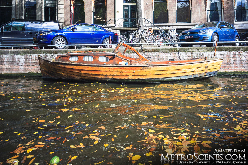 Amsterdam canal boat in the fall