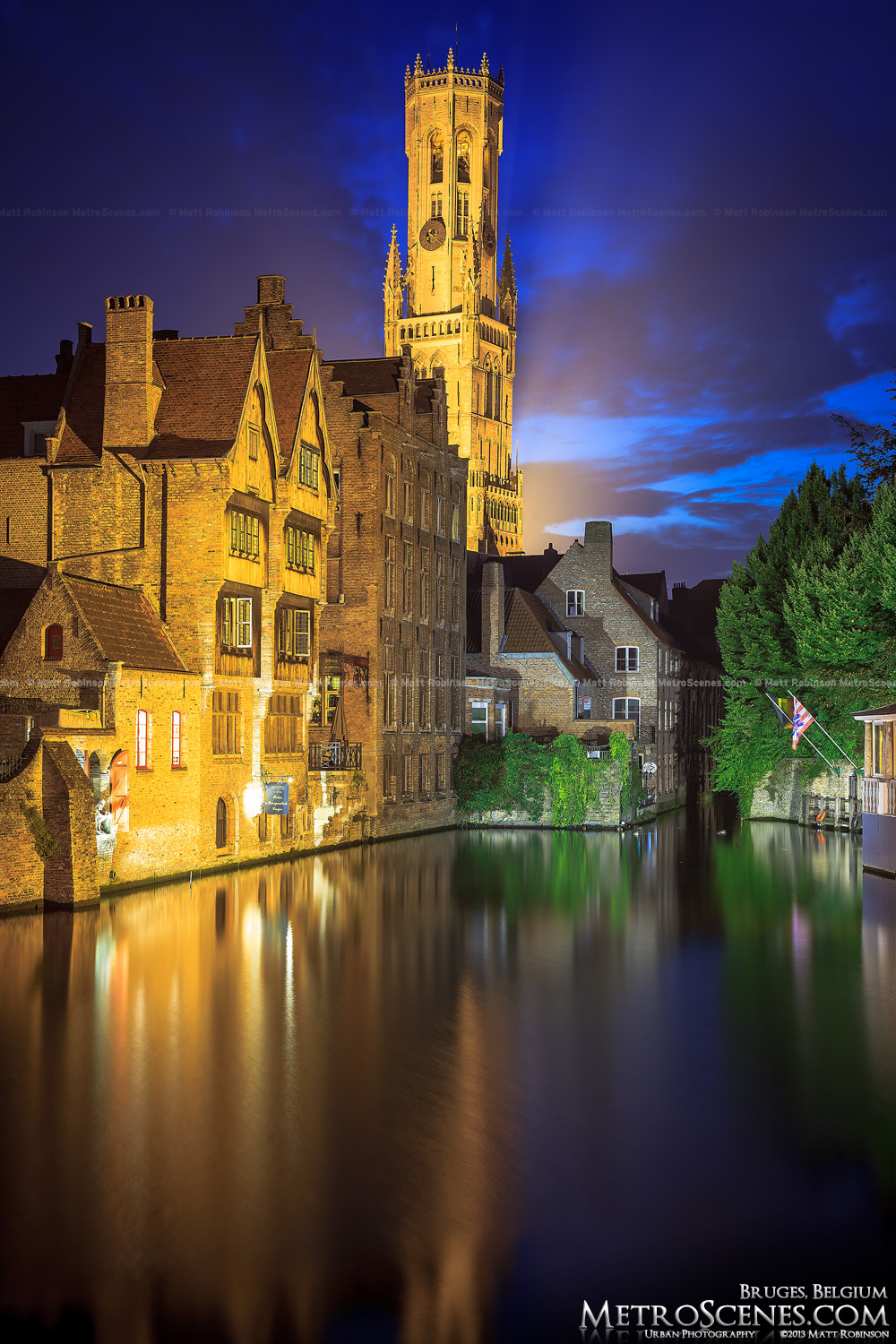Dijver Canal at dusk with the Belfrey of Bruges